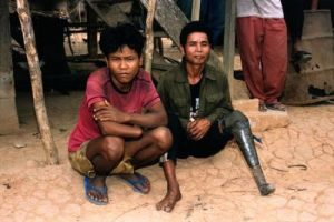 Two victims of cluster munitions in Ta Oy Province, Laos. Credit: John Rodsted