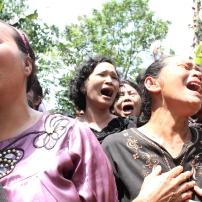 Congregation members from HKBP Taman Sari in Setu, Bekasi, cry as authorities knocked down their church.